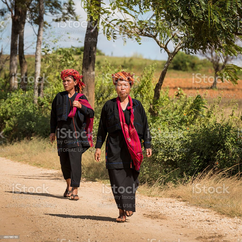 Hmong women walking near Heho-Pindaya Rd, Myanmar stock photo