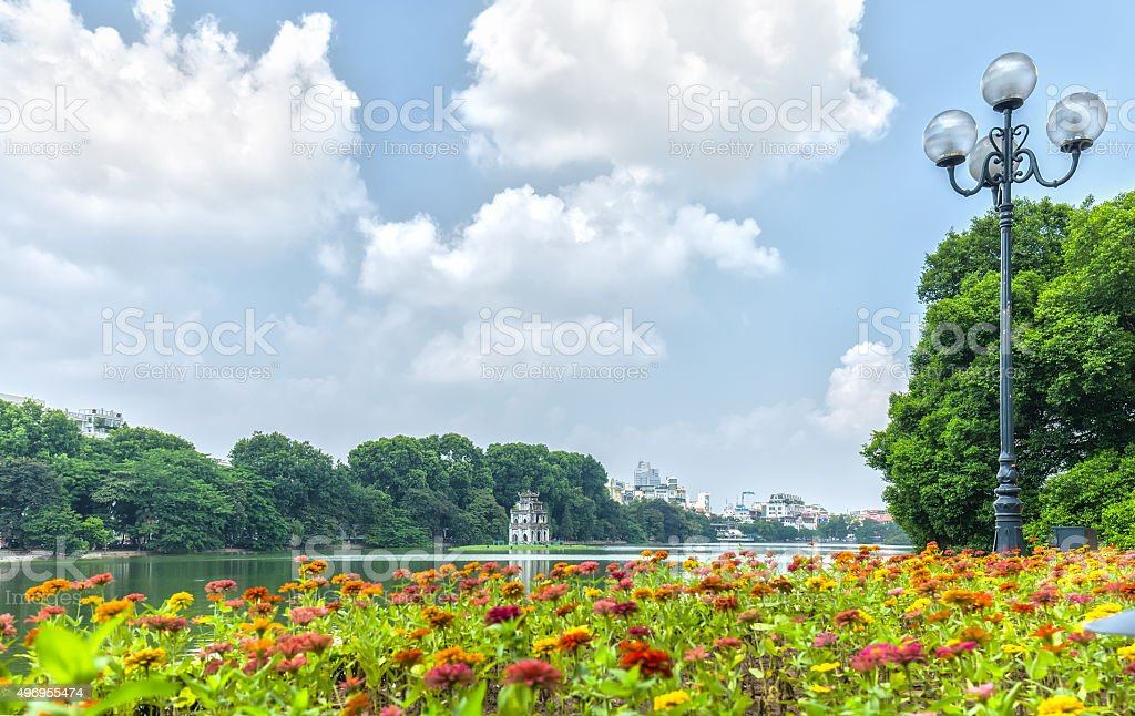 Hoan Kiem lake Tortoises tower inside beautiful flower carpet stock photo