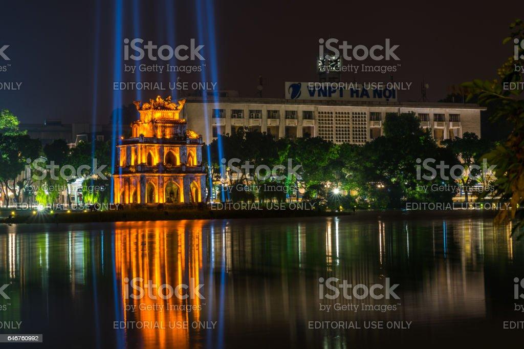 Hanoi, Vietnam - Aug 11, 2016: Hoan Kiem lake with Turtle Tower ( Thap Rua) in center of Hanoi, Vietnam. stock photo