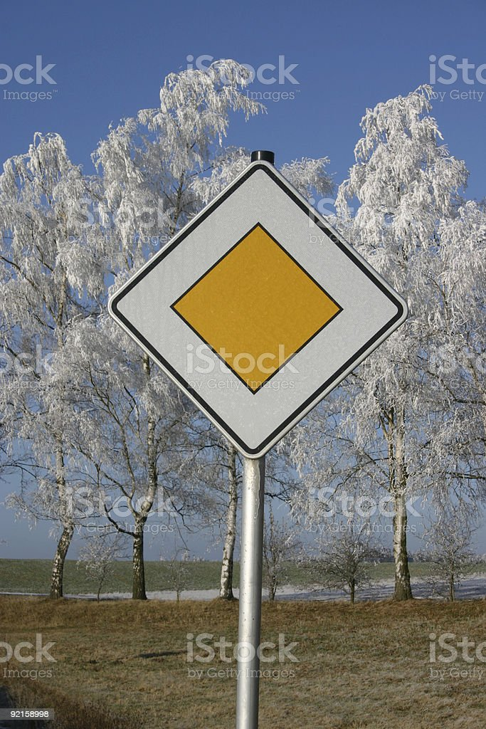 hoarfrost and traffic sign stock photo