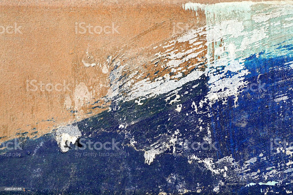 Hoarse,scratched and peeled surface  with blue and yellowish-bro stock photo