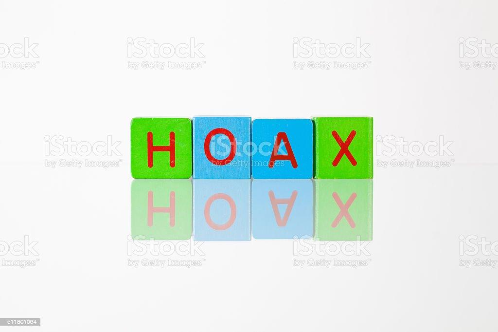 Hoax - an inscription from children's blocks stock photo