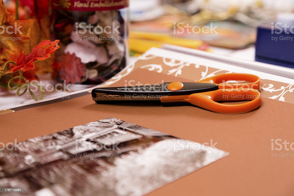 Hobbies:  Scrapbooking and art supplies on craft work table. royalty-free stock photo