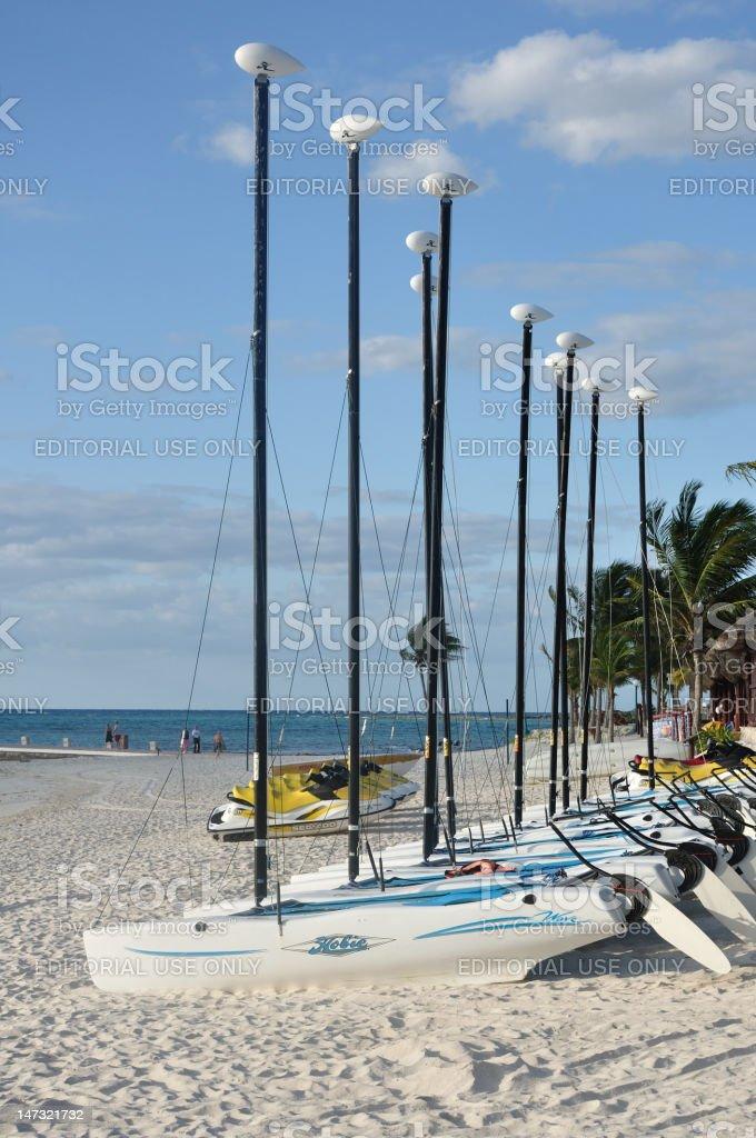 Hobie Cat Sailboats on a Tropical Beach stock photo