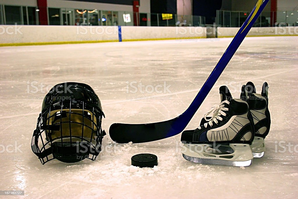 Hockey equipment displayed on ice in rink stock photo