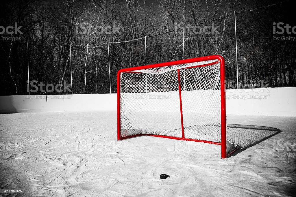 Hockey Goal, Puck, Selective Color Red - Dramatic Lighting stock photo