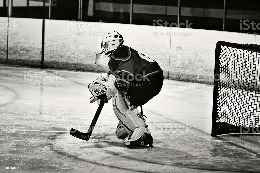 Hockey goalie defending the goal in black and white royalty-free stock photo