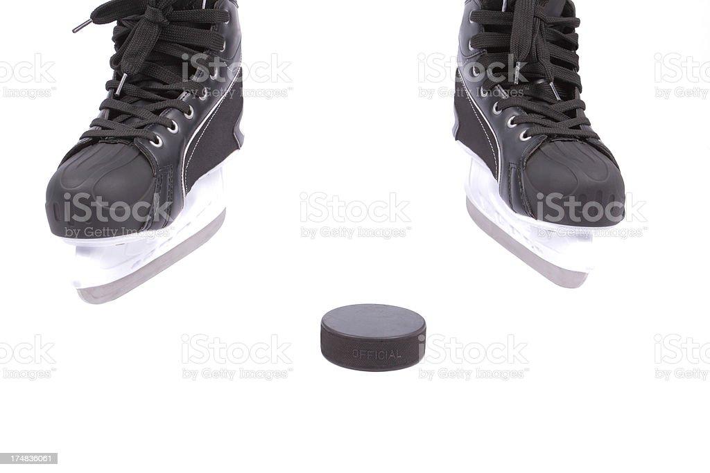 Hockey ice-skating and puck royalty-free stock photo