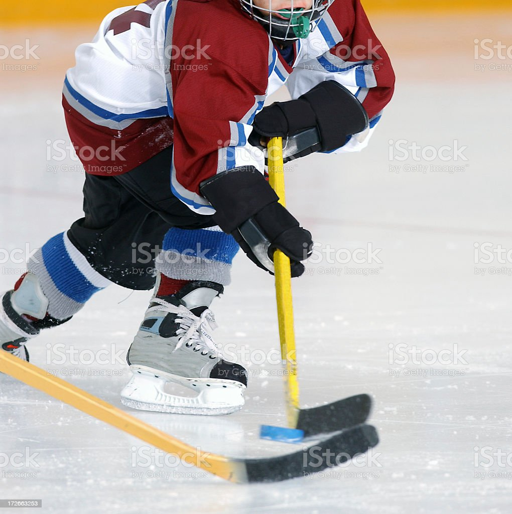 Hockey Player Hits the Pass royalty-free stock photo