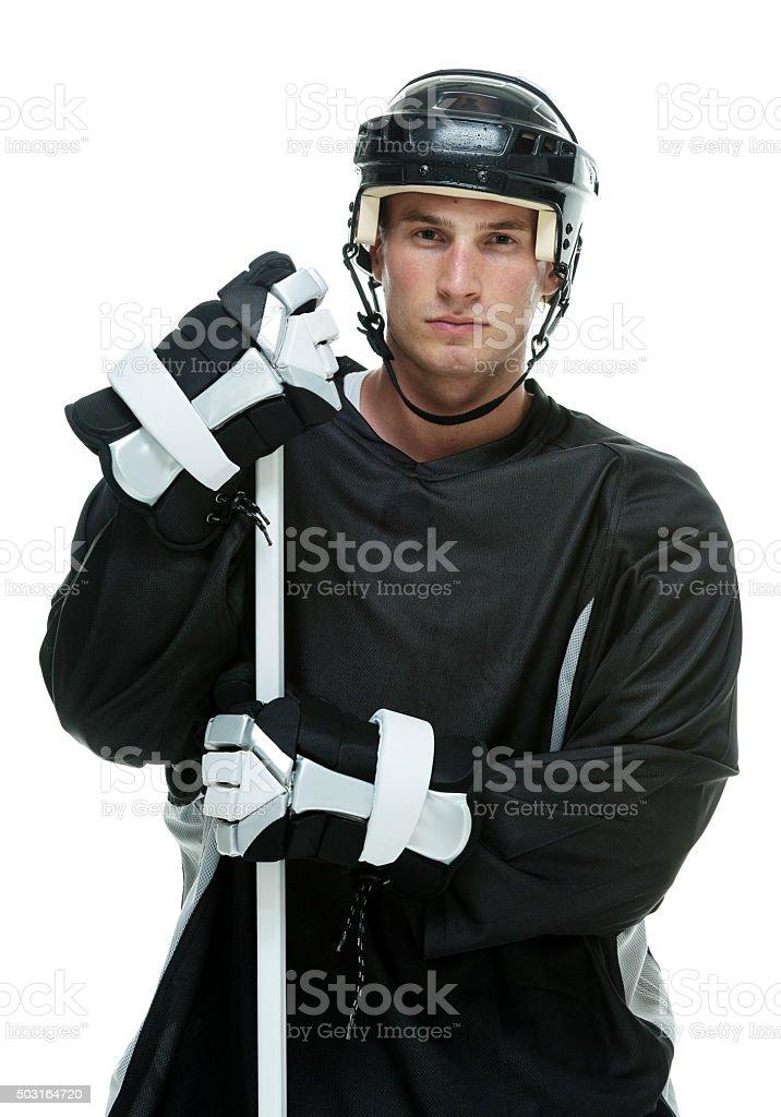 Hockey player holding stick stock photo