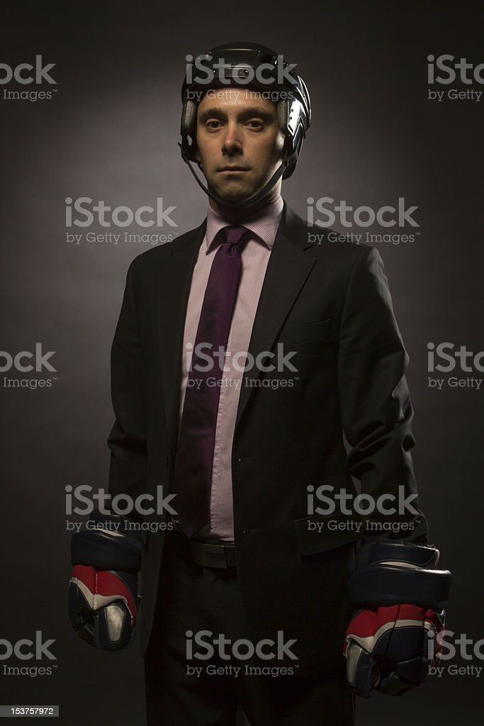 hockey player in suit royalty-free stock photo