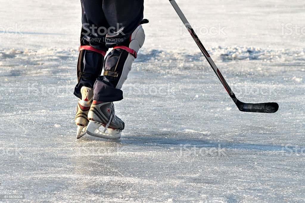 Hockey player practising on a frozen pond stock photo