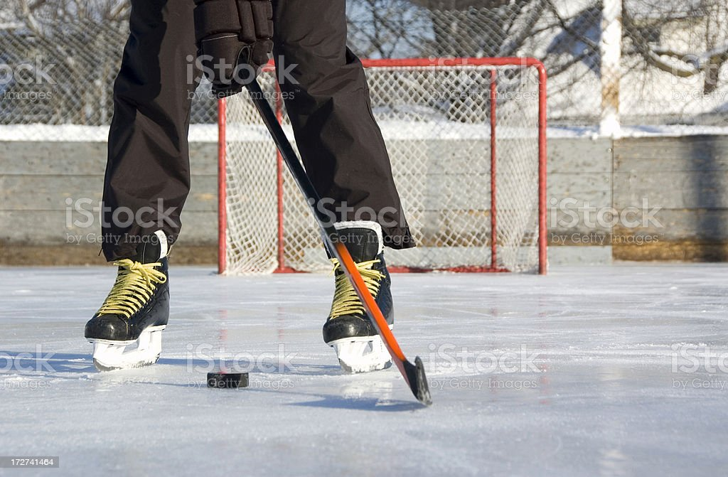 Hockey player with puck royalty-free stock photo