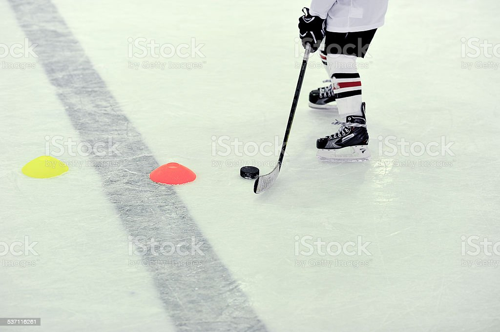 hockey player with the puck on training stock photo