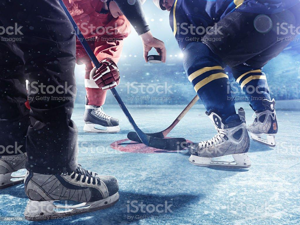 Hockey players and referee start of the match stock photo