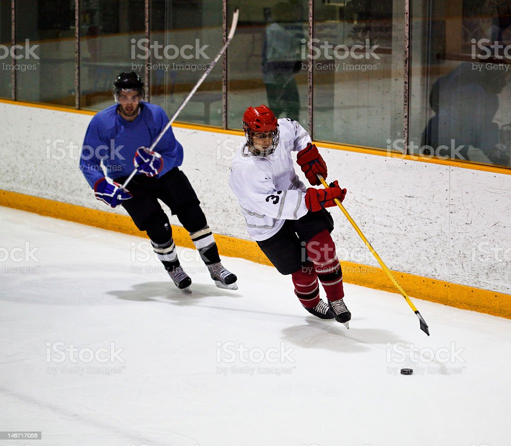 Hockey players from opposite teams stock photo