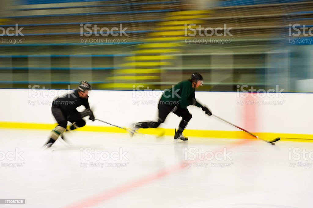 Hockey Players racing royalty-free stock photo