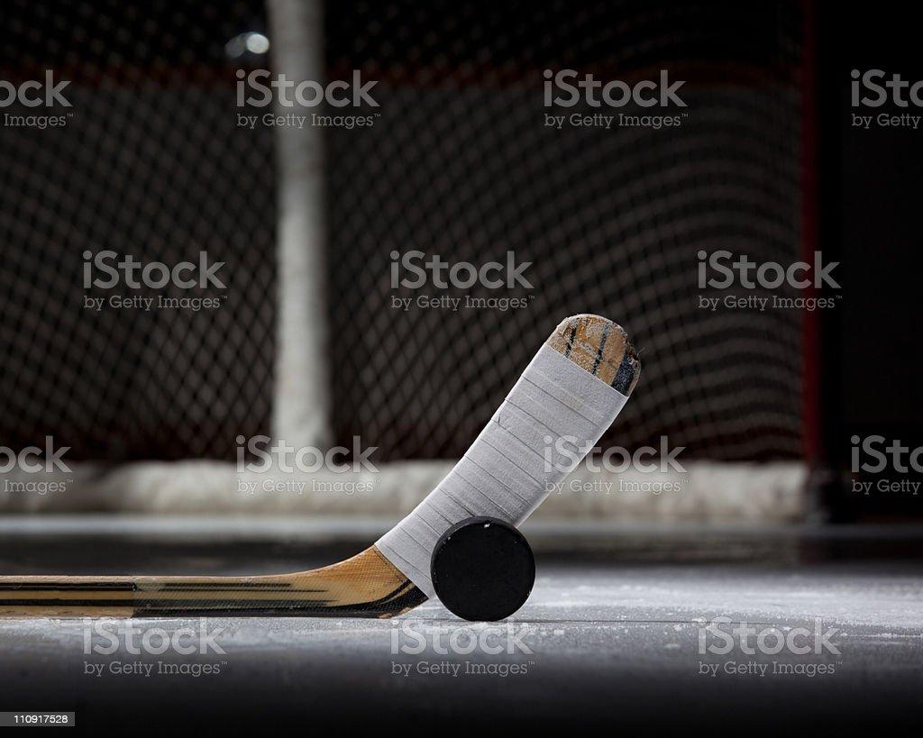 Hockey Puck, Stick, and Net (landscape) stock photo