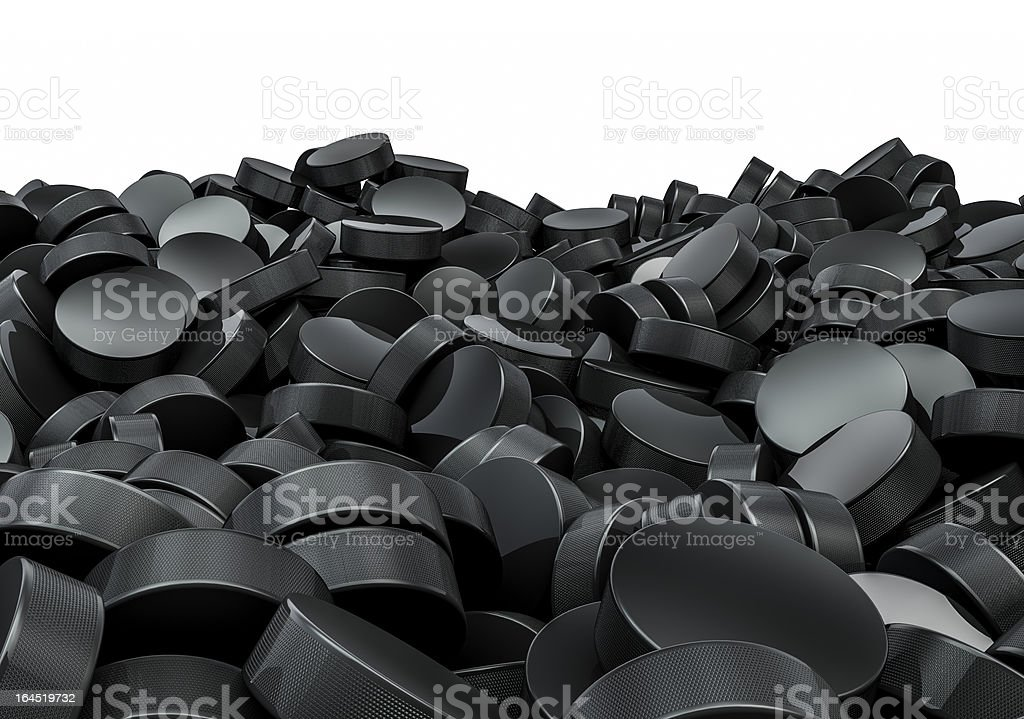 Hockey pucks pile royalty-free stock photo