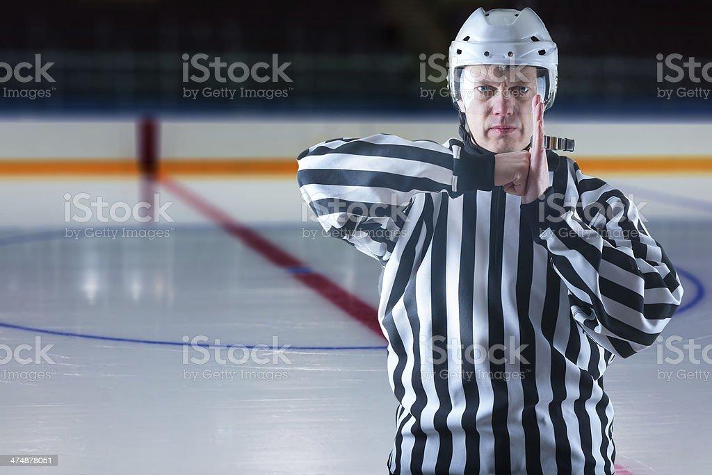 Hockey referee demonstrate a penalty stock photo