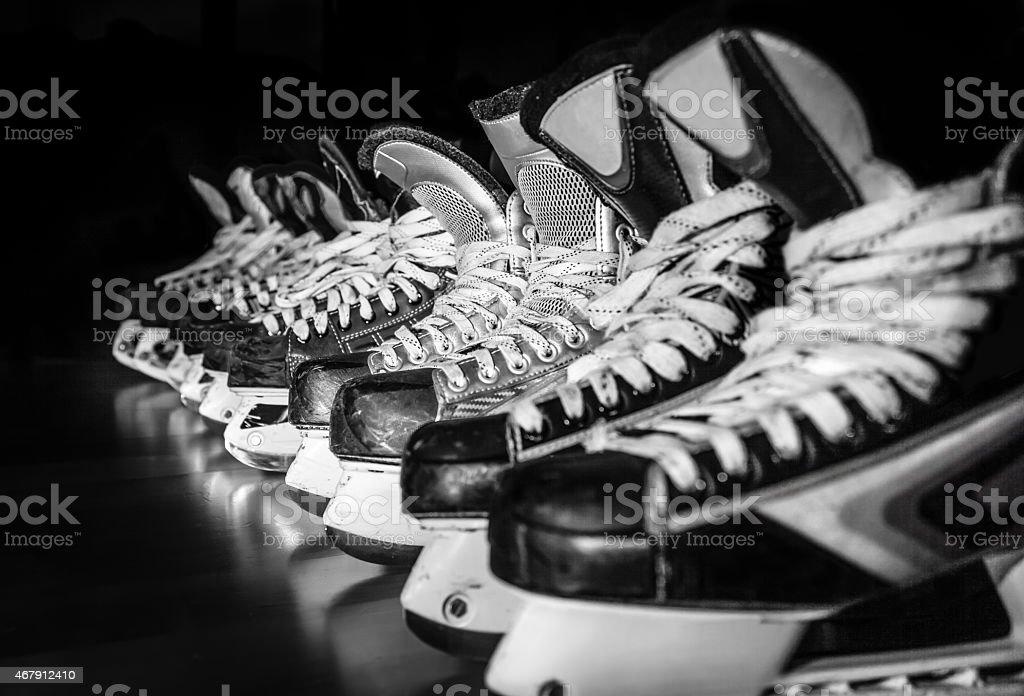 Hockey skates lined up in locker room stock photo