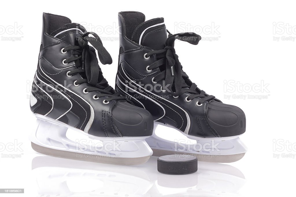 Hockey skates on ice royalty-free stock photo