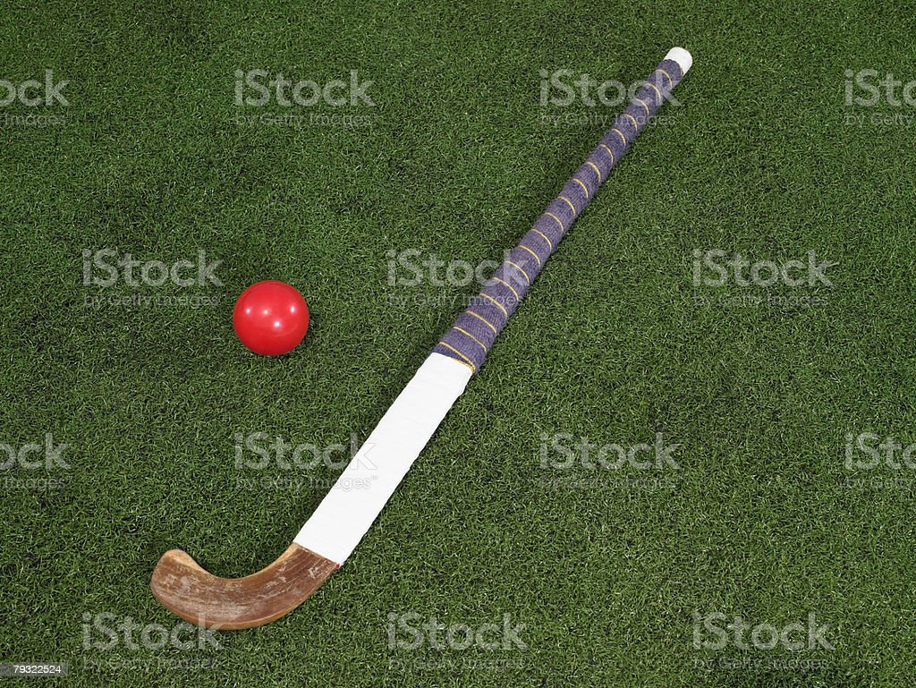 A hockey stick and a ball stock photo