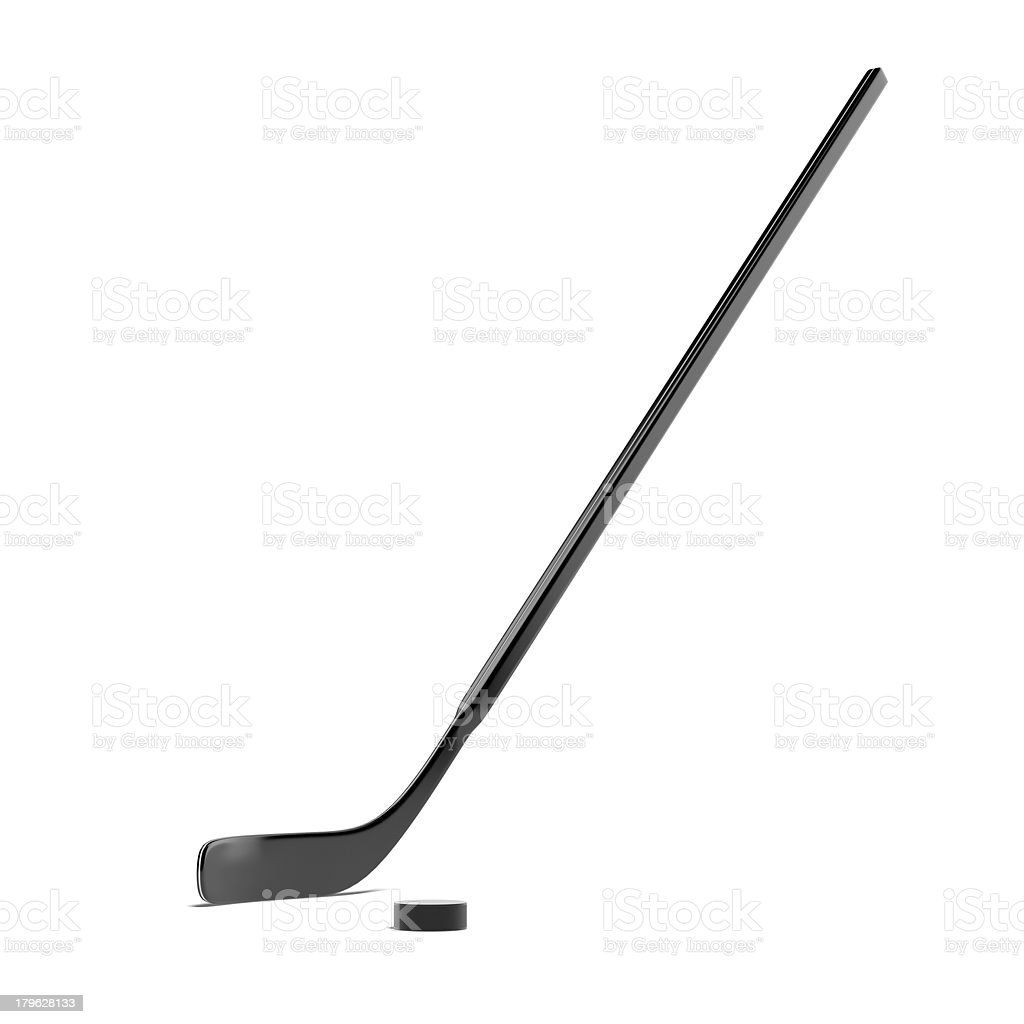 Hockey stick and a puck against a white background stock photo