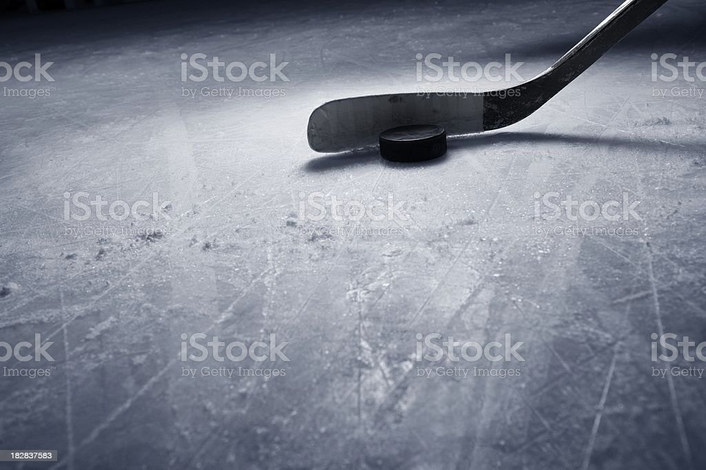 Hockey Stick and Puck on Ice royalty-free stock photo