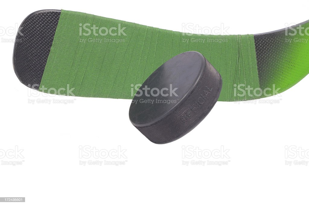hockey stick and puck royalty-free stock photo