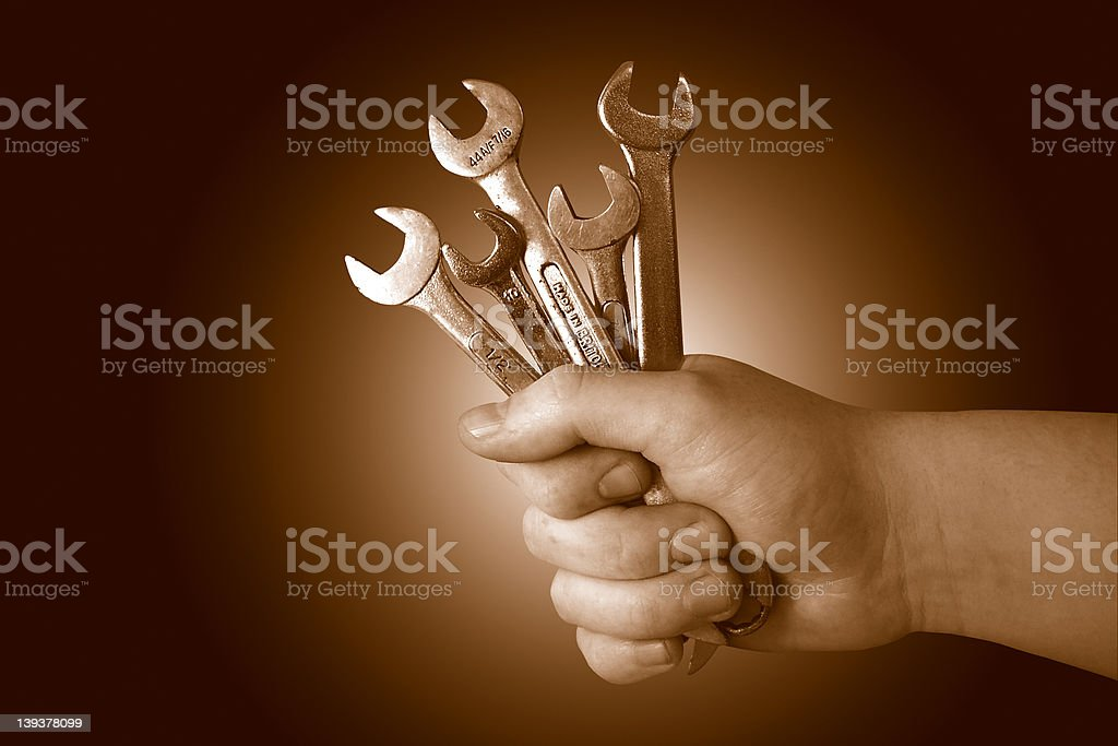 Hoding Spanners Up royalty-free stock photo