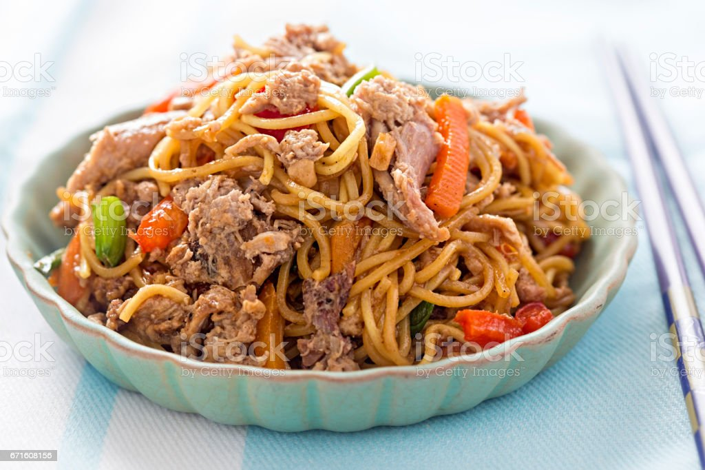 Hoisin duck with pasta and vegetables stock photo
