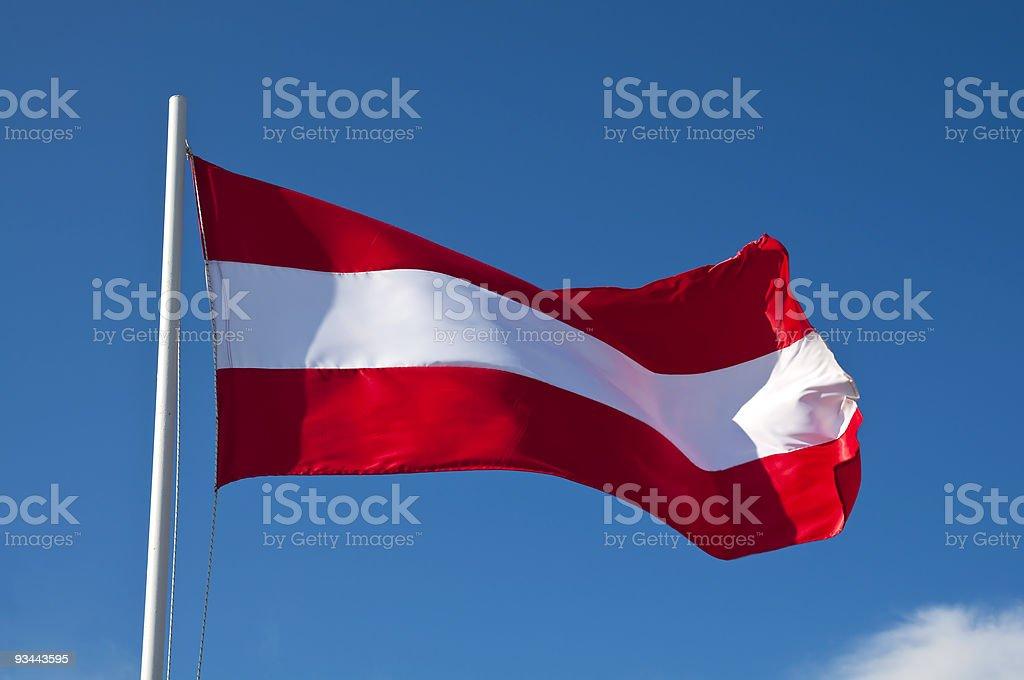 Hoisted flag of Austria on blue sky background stock photo