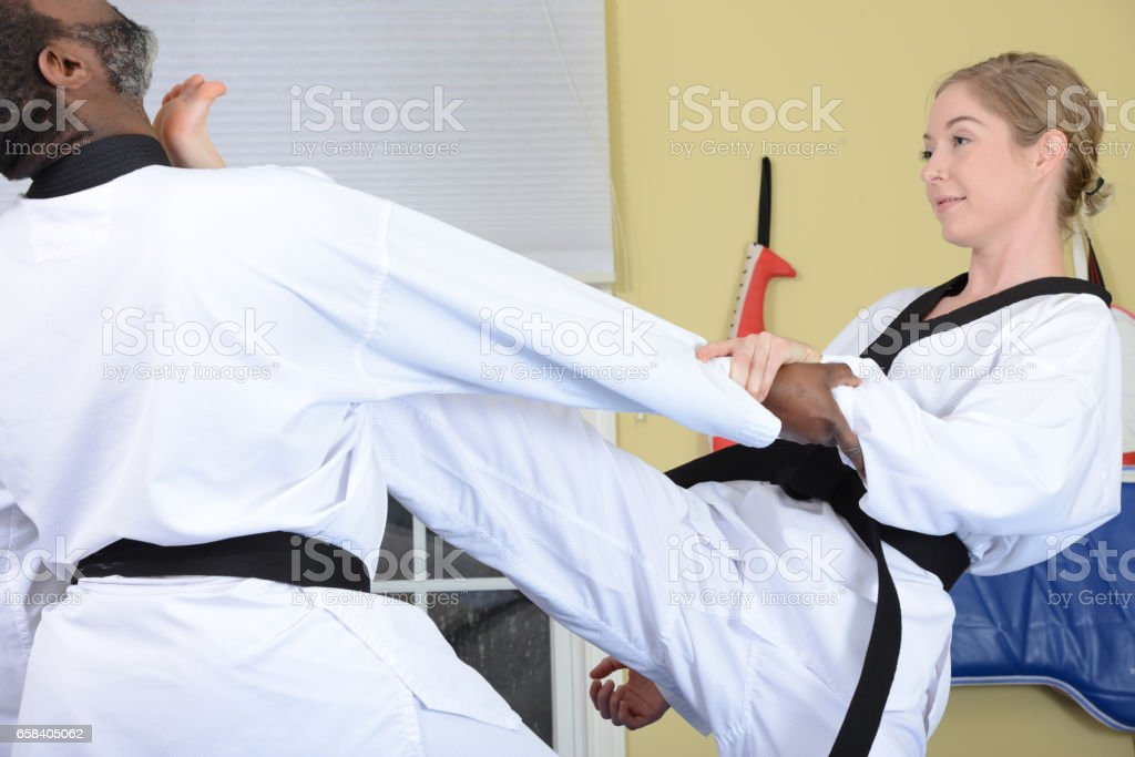 Hold and Kick stock photo