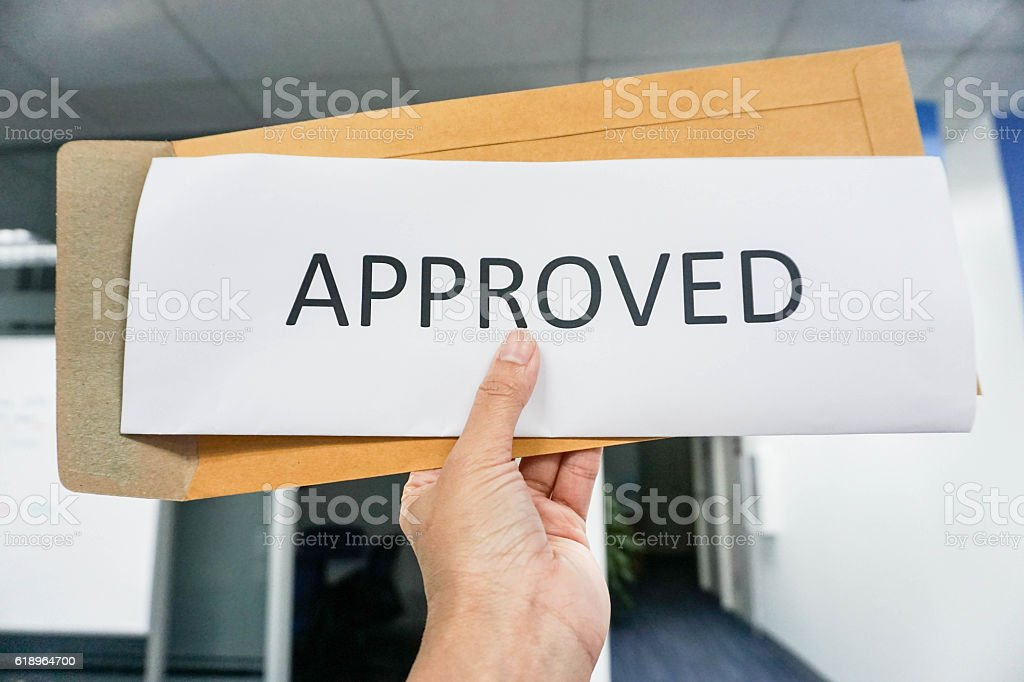 Hold business icon of approve in hand stock photo