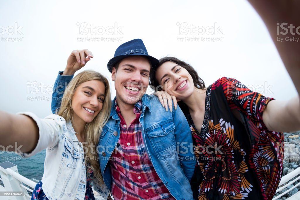 Hold firmly girls, we are taking a selfie stock photo