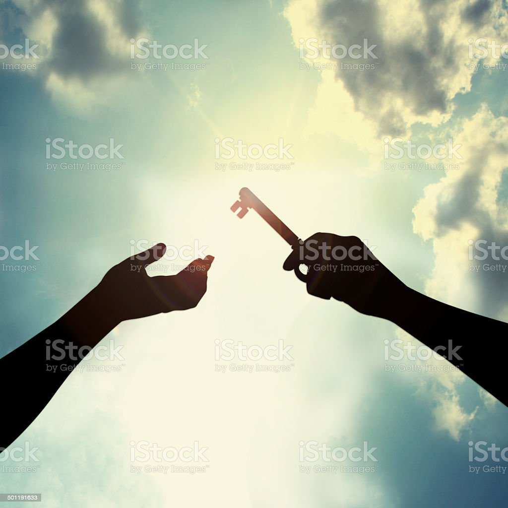 Hold key in sky stock photo