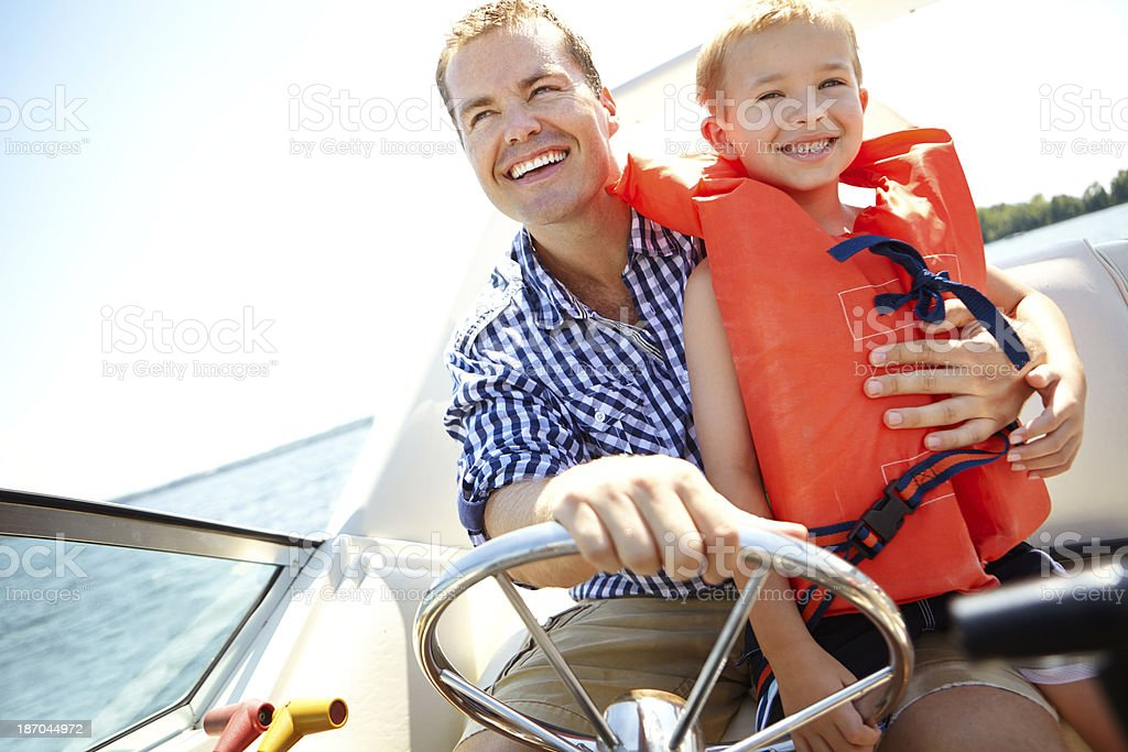 Hold on, dad! stock photo