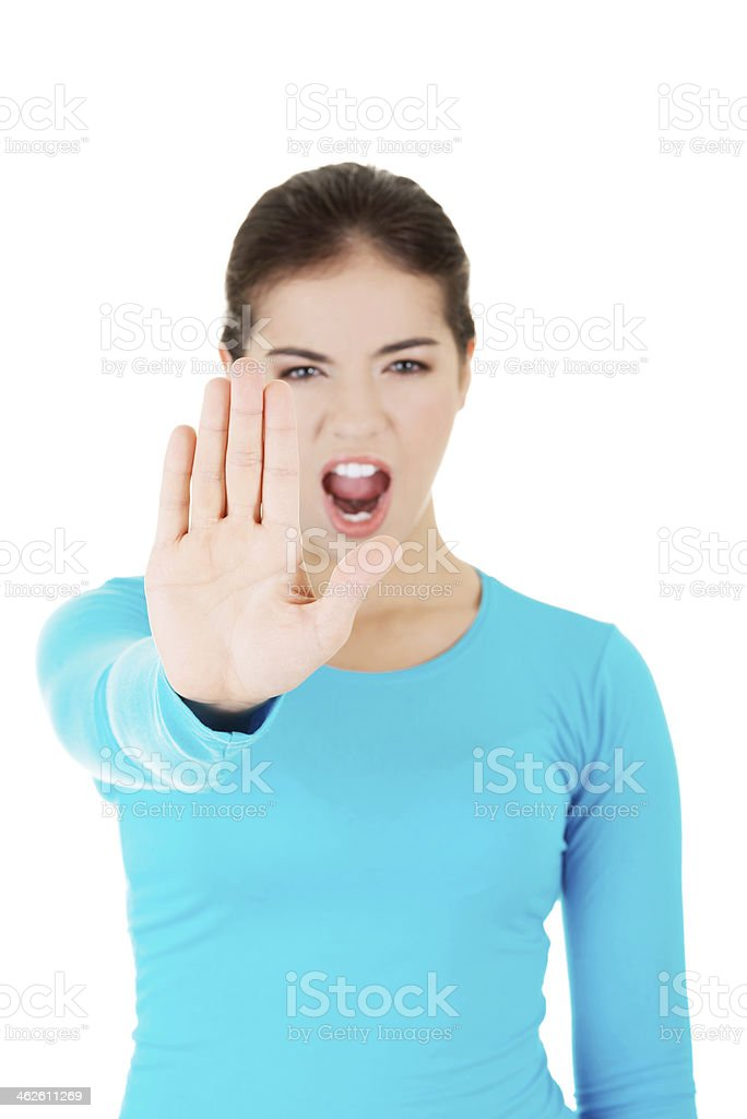 Hold on, Stop gesture showed by young woman stock photo