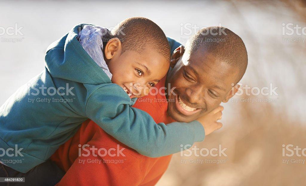 Hold on tight, son stock photo