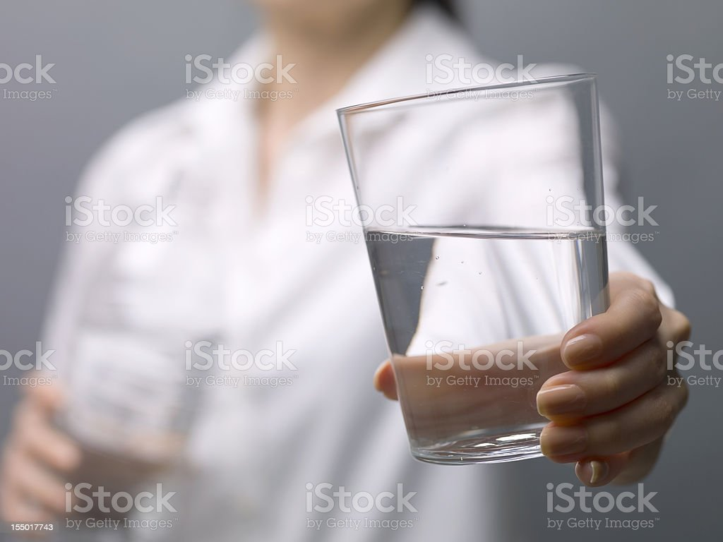 Hold out a glass of water for stock photo