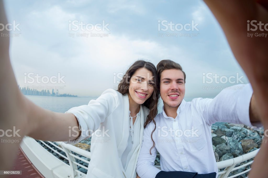 Hold the camera firmly, we are going to take a selfie stock photo