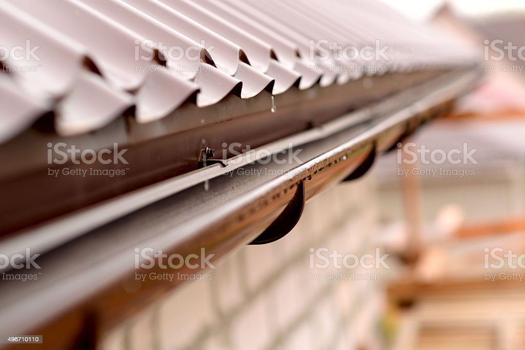 Holder gutter drainage system on the roof stock photo