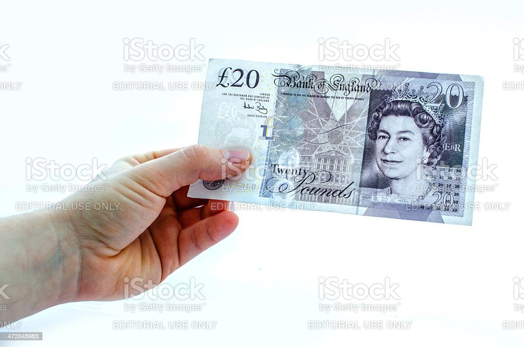 Holding a 20 pound note stock photo
