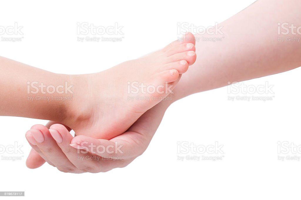 Holding a baby feet isolated on white background stock photo