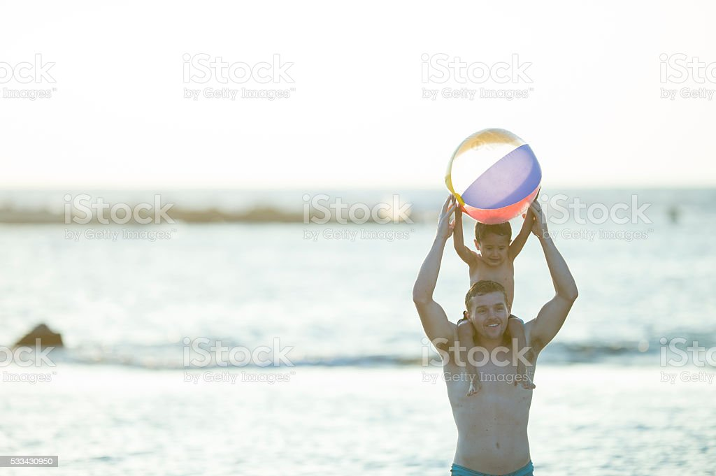 Holding a Beach Ball stock photo