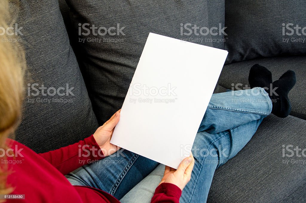 Holding a blank brochure with copy space stock photo