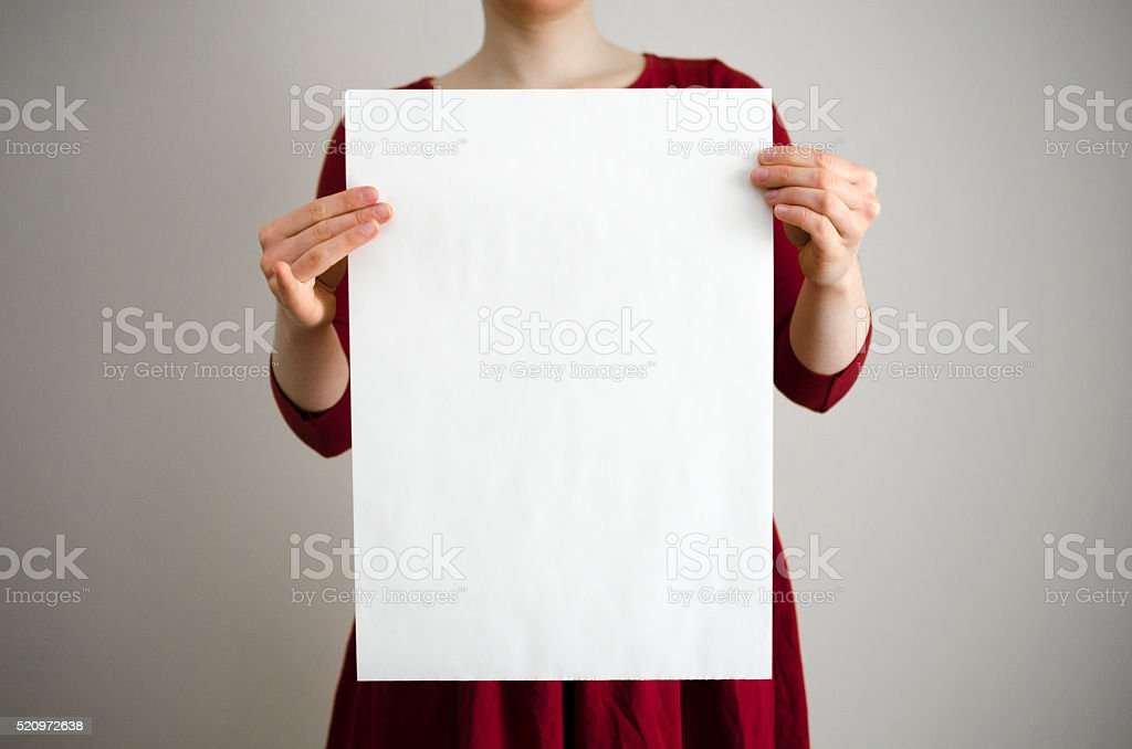 Holding a blank poster with copy space stock photo