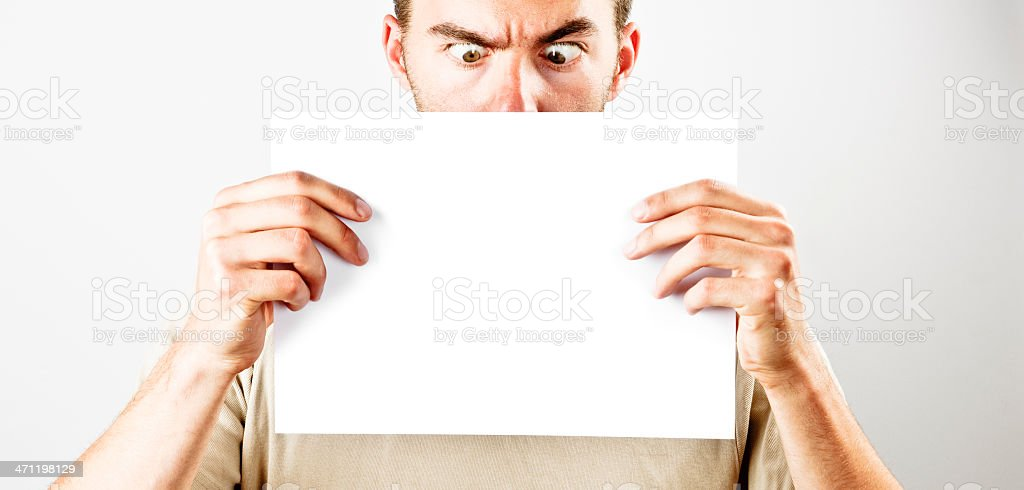 Holding a blank sign royalty-free stock photo