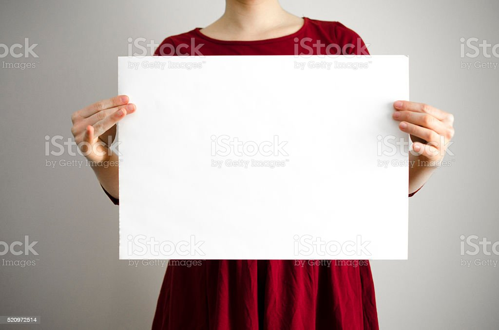 Holding a blank sign with copy space stock photo